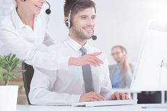 Customer service consultant. Young customer service consultant working in modern office Royalty Free Stock Photography