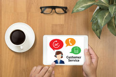 THE CUSTOMER SERVICE and Customer Service Call Center Agent Care. (Target Market Support Assistance) businessman working   on office table with digital tablet Royalty Free Stock Photo