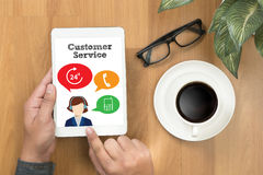 THE CUSTOMER SERVICE and Customer Service Call Center Agent Care. (Target Market Support Assistance) businessman working   on office table with digital tablet Stock Photography