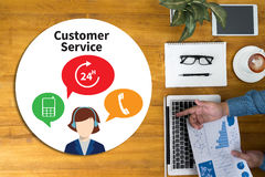THE CUSTOMER SERVICE and Customer Service Call Center Agent Care. (Target Market Support Assistance) Businessman working at office desk and using computer and Stock Photos