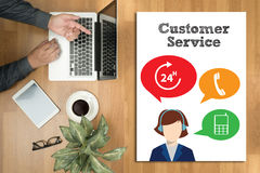 THE CUSTOMER SERVICE and Customer Service Call Center Agent Care. (Target Market Support Assistance) Hipster wooden desktop with laptop, office accessories Stock Photo
