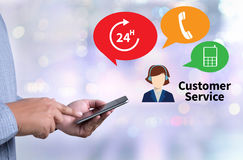 THE CUSTOMER SERVICE and Customer Service Call Center Agent Care. (Target Market Support Assistance) person holding a smartphone on blurred cityscape background Royalty Free Stock Images