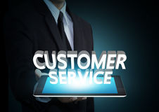 Customer service 3D text on touch screen tablet technology. Business concept Stock Photo