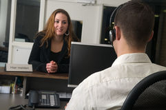 Customer at a service desk. Customer getting some information at a service desk Stock Image