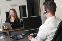 Customer at a service desk. Customer getting some information at a service desk Royalty Free Stock Image