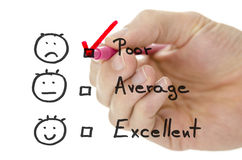 Customer service evaluation form with tick on poor Stock Photos