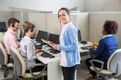 Customer Service Executive Standing By Colleagues Royalty Free Stock Photography