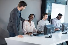 Customer service executive trainer monitoring her team royalty free stock images