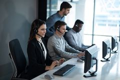 Customer service executive trainer monitoring her team stock image