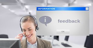 Customer service executive using headset by dialog box Stock Photos