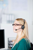 Customer Service Executive Using Headset While Looking Away Stock Photo