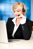 Customer service executive on working Stock Photography