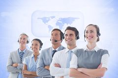 Customer service executives standing with their arms crossed Stock Photos