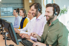 Customer service executives working in call center Stock Image