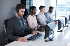 Customer service executives working at office stock photo