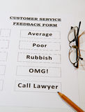 Customer Service Feedback Joke Form. Blank Customer Service Feedback Form with bad options including `Oh My God`and `Call Lawyers` on brown background Royalty Free Stock Images
