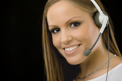 Customer service girl. Young happy beautiful customer service operator girl in headset, smiling, isolated on black background stock photography