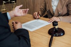Customer service good cooperation, Consultation between a Businesswoman and Male lawyer or judge consult having team meeting with. Client, Law and Legal royalty free stock image