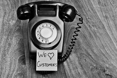 Customer service. Good old fashioned customer service concept, talking to people rather than doing everything online Royalty Free Stock Photography