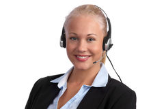 Customer service with a great smile. Blond, caucasian beautiful female customer representative with headset ready for serving your customers Royalty Free Stock Images