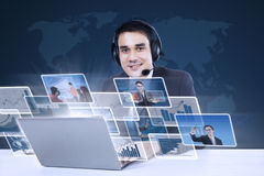 Customer service with internet online on blue. World map background Stock Photos