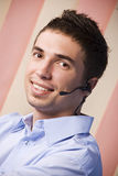 Customer service male operator. Portrait of customer service operator male smiling and looking you.Check also,for pictures similar or the same series Customer Royalty Free Stock Photography