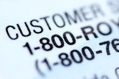 Customer service number. Part of credit card. Macro Stock Photography
