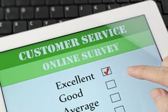 Customer service online survey. Online customer service satisfaction survey on a digital tablet Royalty Free Stock Photos