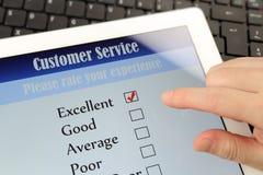 Customer service online survey. Online customer service satisfaction survey on a digital tablet Royalty Free Stock Photography