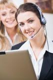 Customer service operator. Portrait of friendly customer service operator smiling with charming confident smile Royalty Free Stock Photo
