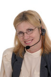 Customer Service Operator 7118. Attractive, smiling, customer service operator representative with telephone headset wearing glasses stock photo