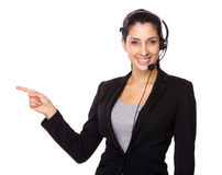 Customer service operator with finger point up Royalty Free Stock Images