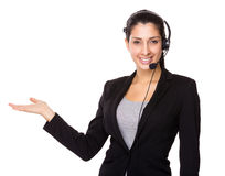 Customer service operator with open hand palm Royalty Free Stock Image