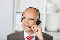 Customer Service Operator Using Headset In Office Royalty Free Stock Image