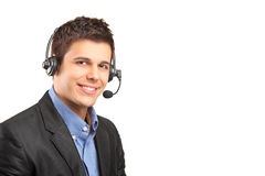 Customer service operator wearing a headset. Portrait of a handsome customer service operator wearing a headset isolated on white background Royalty Free Stock Photo