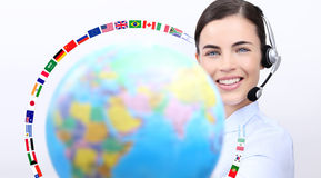 Customer service operator woman with headset smiling, globe Stock Images