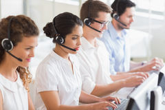 Customer service operators working at desk Stock Photos