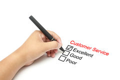 Customer service performance evaluation. Businessman hand with pen on white background Stock Photography