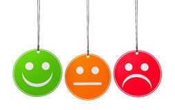 Customer Service Quality Survey. Customer service and product quality survey concept with three emoticon icons and symbol on round badges isolated on white Stock Photo