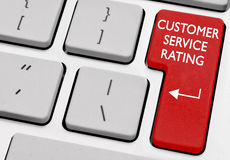 Customer service rating. Computer with red key customer service rating Royalty Free Stock Image