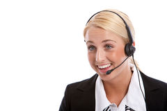 Customer service rep. Attractive young woman with headphone set on white background Royalty Free Stock Photo