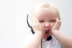 Customer Service Representative. Young boy wearing telephone headset Stock Photography