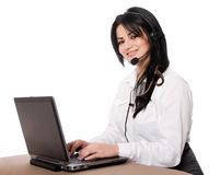 Customer service representative. Beautiful happy customer service representative at call center office desk with headset and laptop computer online chatting Stock Photos