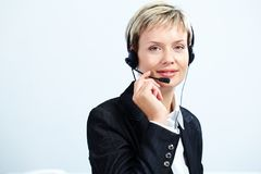 Customer service representative. Portrait of customer service representative answering a call Stock Photos