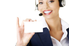Customer service representative. Smiling customer service representative with headset holding a blank empty card. Isolated on white background Stock Photos