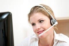 Customer service representative. Young customer service representative online with a computer Stock Photo
