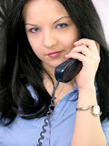Customer Service Representative. Closeup of a woman talking on the phone. Possible concept for a customer support or communication-related design stock image