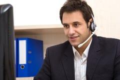 Customer service representative. Male customer service representative working at the office Stock Images