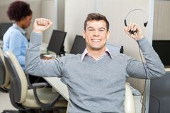 Customer Service Representative With Arms Raised Royalty Free Stock Photo