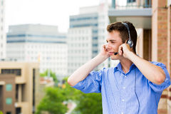 Customer service representative or call center agent or support or operator with headset on outside balcony Stock Photo